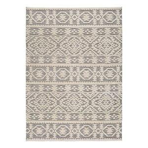 Béžový koberec Universal Piazza Ornament, 133 x 190 cm